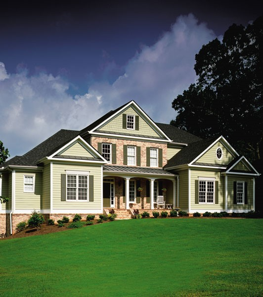 who says that your home exterior design needs to feature just one type of material let alone one type of siding this home makes great use of brick