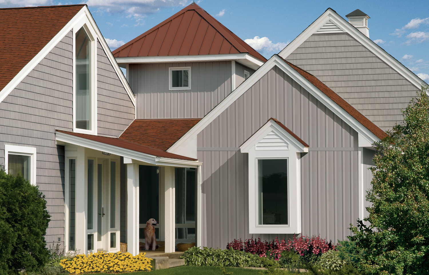 By mixing and matching shingles with board and batten siding in the same color it emphasizes the architecture and creates a