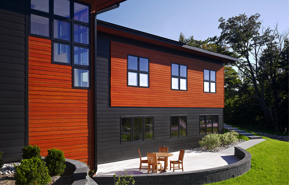 from moving at an angle across the upper portion of the home to following the long lines of the deck around the middle this modern siding flows perfectly - Modern Home Exterior Siding