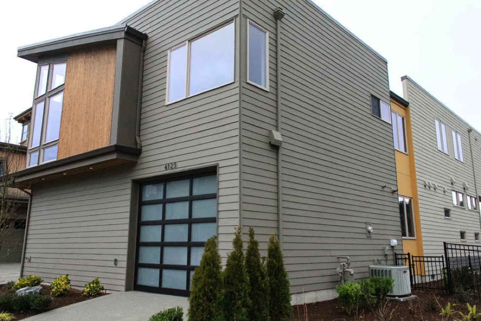 as long as some modern elements exist on the buildings exterior its also possible to use predominately traditional siding such as this horizontal lap